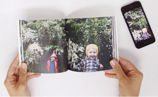 Artifact Uprising book and phone