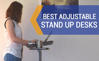 Kimberly standing at a portable standing desk working (caption: Best Adjustable Standing Desk)
