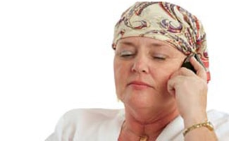 Cancer patient holding phone