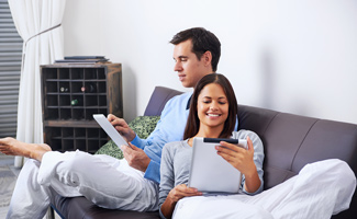 Couple reading tablets