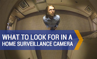Man looking into security camera: What to Consider for Home Surveillance Cameras