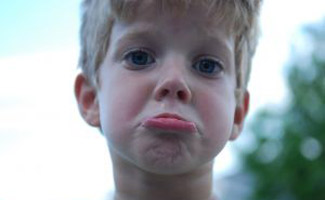 Kid frowning