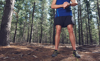 Man hiking with fitness tracker