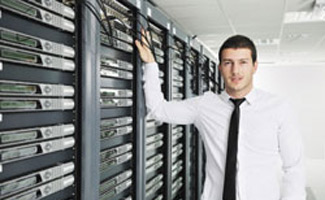 Man standing next to servers