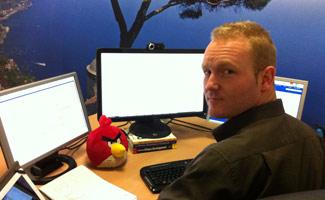 Peter Coppinger at desk