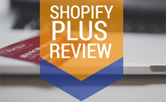 Credit card on laptop: Shopify Plus Review