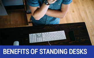 man standing at desk
