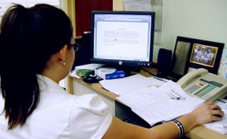 Virtual assistant sitting at desk