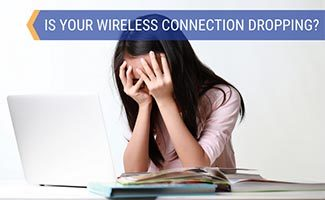 Girl frustrated with computer (caption: Is Your Wireless Connection Dropping?)