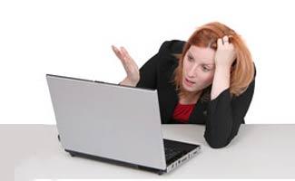 Woman mad at computer