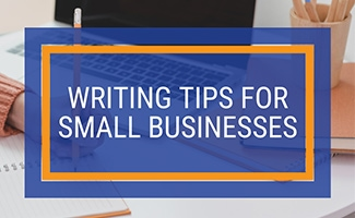 Person writing next to computer (Caption: Writing Tips For Small Businesses)