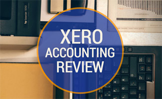 Laptop with accounting paperowrk: Xero Accounting Review